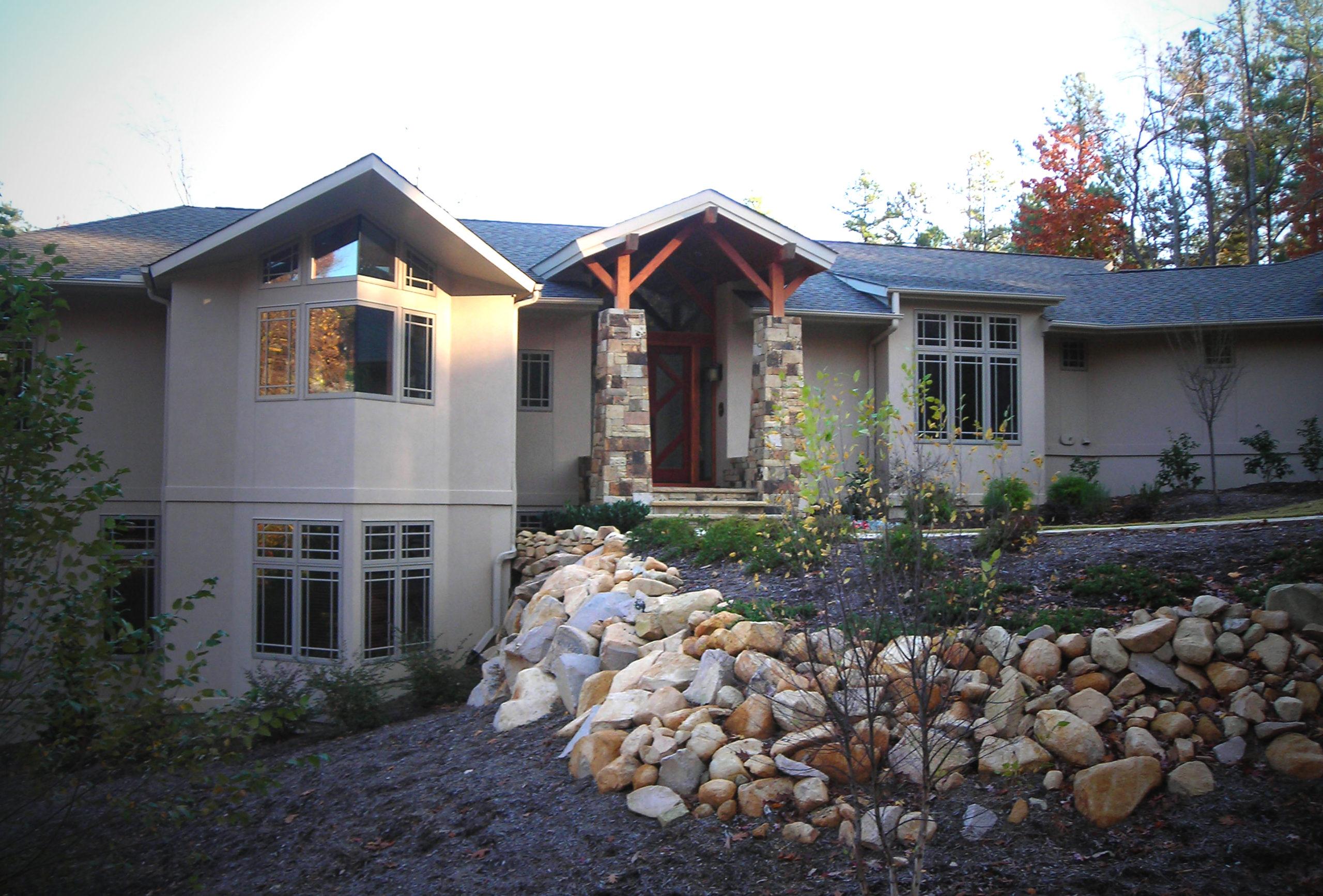 Photo of a custom home exterior.