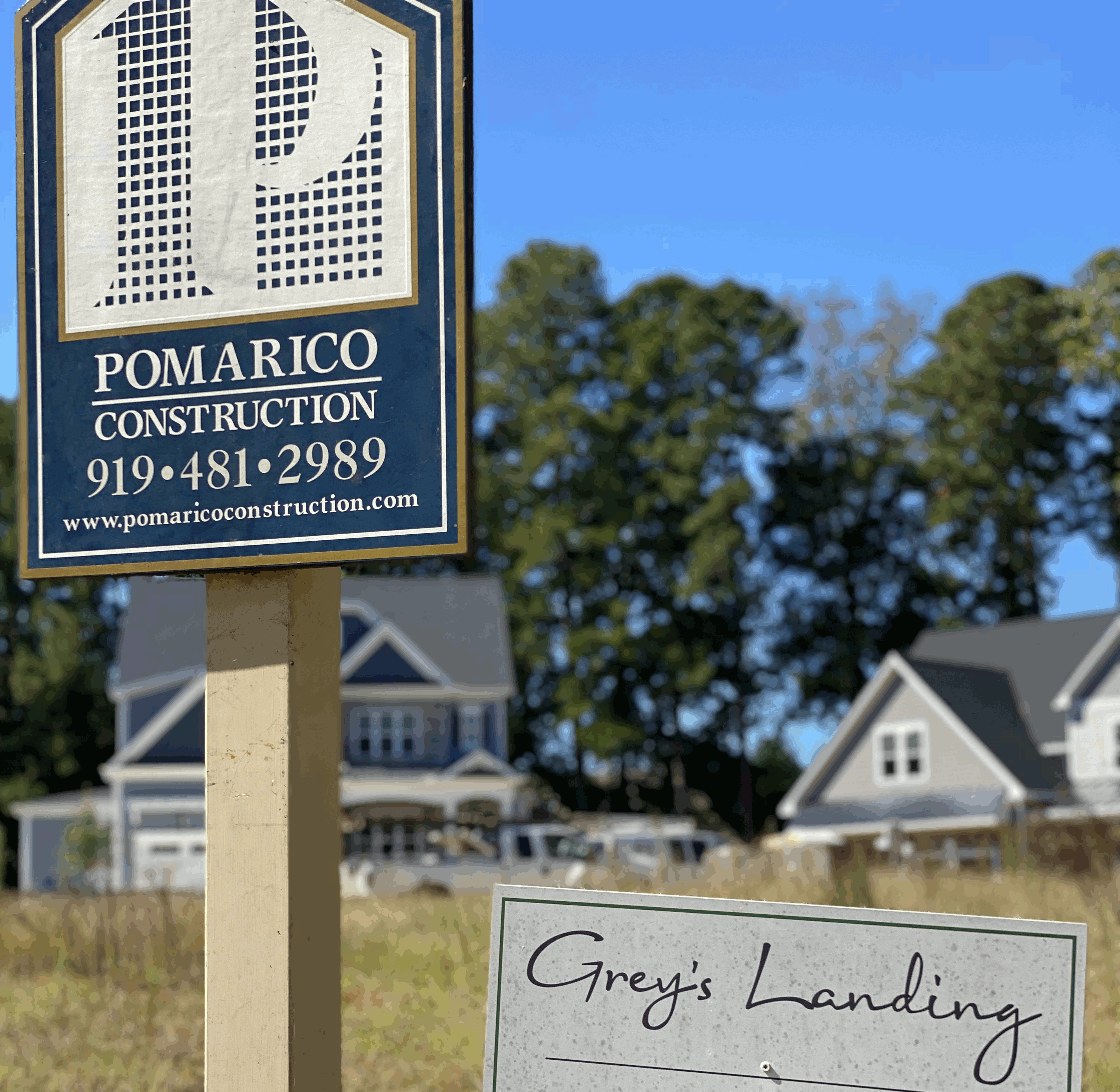 Photo of the Pomarico Construction company sign on a Grey's Landing ready to build lot.